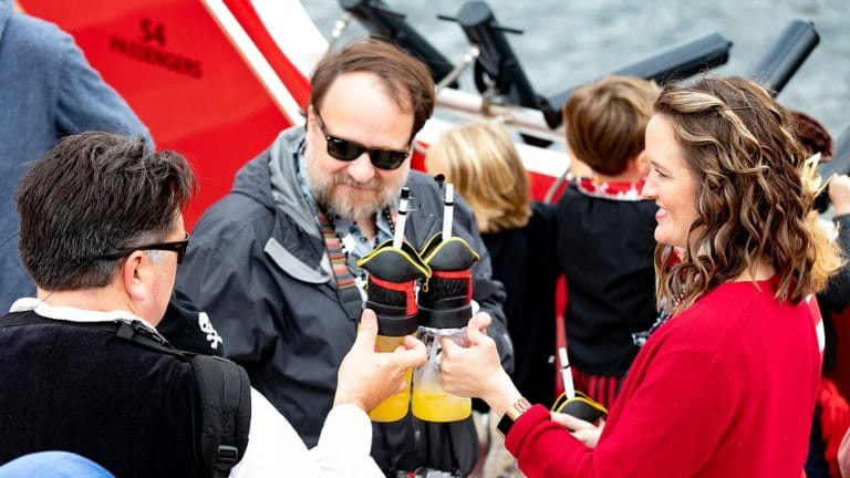 people toasting with pirate cups